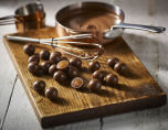 Kolakulor doppade i mjölkchoklad - Thorntons